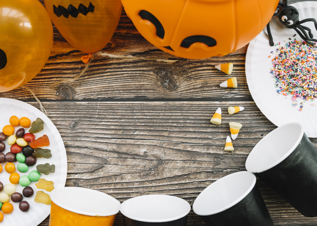 Bfc5d8fe halloween composition with paper cups and sweets 23 2147894921